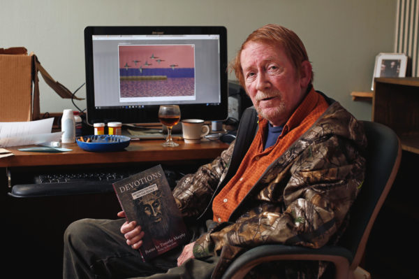 """Fargo poet Tim Murphy has a new book featuring his latest work titled """"Devotions."""" David Samson / The Forum"""